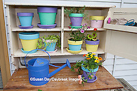 63821-20101 Potting bench with containers and flowers in spring, Marion Co. IL