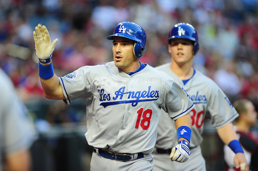 May 21, 2012; Phoenix, AZ, USA; Los Angeles Dodgers catcher Matt Treanor (18) is congratulated by teammates after hitting a two run home run in the second inning against the Los Angeles Dodgers at Chase Field.  Mandatory Credit: Mark J. Rebilas-