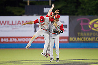 (L-R) Joe Tuschak (9), Tucker Tharp (5) and Michael Bernal (17) celebrate their win over the Hudson Valley Renegades at Dutchess Stadium on June 18, 2014 in Wappingers Falls, New York.  The Cyclones defeated the Renegades 4-3 in 10 innings.  (Brian Westerholt/Four Seam Images)