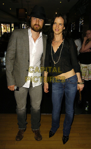 "MARTIN HENDERSON & JULIETTE LEWIS.At the UK Film Premiere of ""Little Fish"",.Curzon Soho, London, England, 16th July 2006..full length juliet black top jeans see through sheer shirt hand on head  hat grey suit beard.Ref: CAN.www.capitalpictures.com.sales@capitalpictures.com.©Can Nguyen/Capital Pictures"