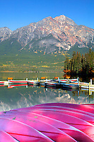 Canoes along the shore of Pyramid Lake with Pyramid Mountain in the background, Jasper National Park, Alberta, Canada.