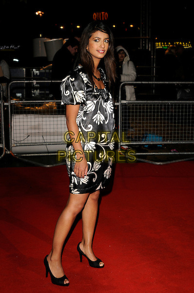 "KONNIE HUQ.""Sweeney Todd: The Demon Barber of Fleet Street"" European film premiere, Odeon cinema, Leicester Square, London, England..January 10th, 2008 .full length black white dress silk satin pattern necklace .CAP/CAN.©Can Nguyen/Capital Pictures"