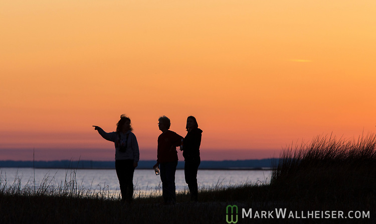 Shell Point residents watch the Snow moon rise over Live Oak Island in Wakulla County along the Forgotten Coast of the Florida panhandle.