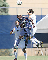 Henry Tembon #21 of Georgetown University goes up for a header against Jeff Ricondo #14 of Michigan State during an NCAA match at North Kehoe Field, Georgetown University on September 5 2010 in Washington D.C. Georgetown won 4-0.