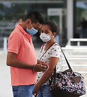 "BOGOTA, COLOMBIA - March 12:  People wear face masks as they arrive to the International airport ""El Dorado"" on March 12, 2020 in Bogota, Colombia. The World Health Organization declared a global pandemic as the coronavirus rapidly spreads across the world. Colombian President Ivan Duque declared a health emergency to contain an outbreak of coronavirus, suspending public events with more than 500 people. (Photo by Daniel Munoz/VIEWpress)"