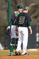 Charlotte 49ers catcher Patric King (28) has a chat on the mound with starting pitcher Brock Hudgens (38) during the game against the Canisius Golden Griffins at Hayes Stadium on February 23, 2014 in Charlotte, North Carolina.  The Golden Griffins defeated the 49ers 10-1.  (Brian Westerholt/Four Seam Images)