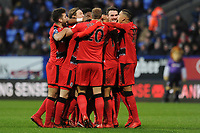 Huddersfield Town players celebrate with Daniel Williams of Huddersfield Town during Bolton Wanderers vs Huddersfield Town, Emirates FA Cup Football at the Macron Stadium on 6th January 2018