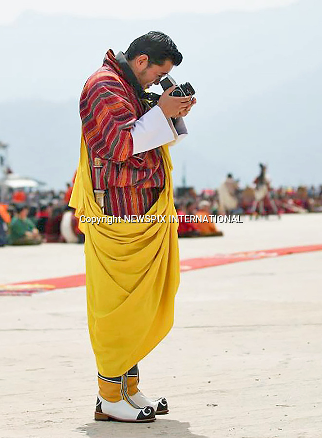 01.09.2016; Thimpu Bhutan: KEEN PHOTOGRAPHER KING WANGCHUCK<br /> The King took the recent adorable images of his son Prince Jigme (The Gyalsey)<br /> Prince Jigme was born on 5th February 2016.<br /> Picture shows: King Wangchuck of Bhutan with his Hasselblad 500C/M.<br /> Mandatory Credit Photo: &copy;Royal Palace/NEWSPIX INTERNATIONAL<br /> <br /> (Failure to credit will incur a surcharge of 100% of reproduction fees)<br /> IMMEDIATE CONFIRMATION OF USAGE REQUIRED:<br /> Newspix International, 31 Chinnery Hill, Bishop's Stortford, ENGLAND CM23 3PS<br /> Tel:+441279 324672  ; Fax: +441279656877<br /> Mobile:  07775681153<br /> e-mail: info@newspixinternational.co.uk<br /> Please refer to usage terms. All Fees Payable To Newspix International