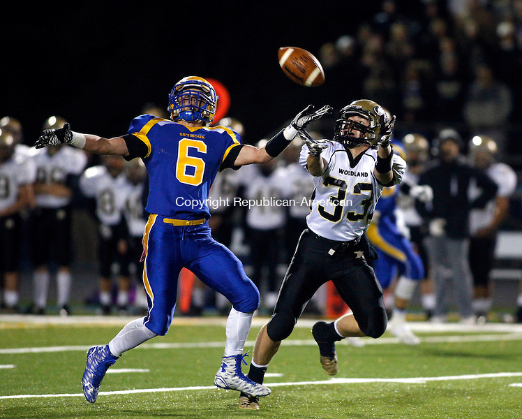 Seymour, CT- 25 November 2015-112515CM08-  Seymour's Bobby Melms (6) defends Woodland's Issac Negron during their NVL matchup in Seymour on Wednesday. The pass was incomplete on the play.   Christopher Massa Republican-American