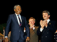 Montreal (Qc) CANADA, June 20, 1990 File Photo.<br />  Jean Dore (R) ; the Mayor of Montreal at that time is applauding.<br /> <br /> South African opposition leader Nelson Mandela (L) after his speech in front the black community in Montreal (Quebec, Canada) on June 20, 1990, while<br /> <br /> Photo (c) 1990, by Pierre Roussel - IMAGES DISTRIBUTION
