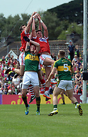 2-7-2017: It takes three Cork palyers to ourjump Kerry's Kieran Donaghy at the Kerry V Cork Munster Football final in Killarney on Sunday.<br /> Photo: Don MacMonagle