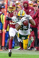 Landover, MD - September 23, 2018: Green Bay Packers running back Aaron Jones (33) almost pulls off a circus catch over Washington Redskins cornerback Quinton Dunbar (23) late in the 4th quarter of game between the Green Bay Packers and the Washington Redskins at FedEx Field in Landover, MD. The Redskins get the win 31-17 over the visiting Packers. (Photo by Phillip Peters/Media Images International)