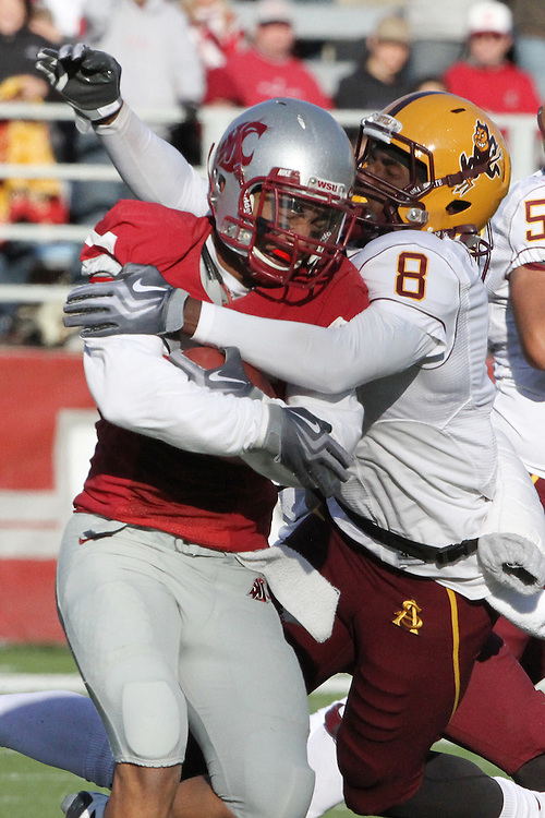 Washington State safety, Xavier Hicks (#26), prepares to shake an attempted tackle by Arizona State wide receiver, Gerrell Robinson (#8), after intercepting a pass during the Cougars Pac-10 conference football game against the Sun Devils at Martin Stadium in Pullman, Washington, on October 10, 2009.