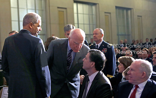 United States Attorney General Eric Holder, left,  U.S. Senator Patrick Leahy (Democrat of Vermont), second left, Director of the Federal Bureau of Investigation (FBI), James Comey, second right, and Director of the Central Intelligence Agency (CIA) John Brennan, right, engage in conversation prior to U.S. President Barack Obama's remarks on signals intelligence programs and how they can be used to protect national security while supporting foreign policy and respecting privacy and civil liberties, at the Department of Justice in Washington DC, on January 17, 2014.<br /> Credit: Aude Guerrucci / Pool via CNP