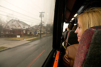 12 March 2006 - New Jersey, USA - A participant in a tour of locations featured in the hit television mob show The Sopranos looks out of the bus in New Jersey, USA, 12 March 2006.