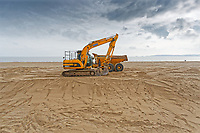 Heavy machinery on the beach in Swansea, Wales, UK. Friday 05 October 2018