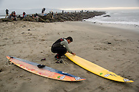 Danilo Couto waxes his board on shore before paddling out to the jet ski during the first round of the 2008 Mavericks Surf Contest in Half Moon Bay, Calif., Saturday, January 12, 2008...Photo by David Calvert/isiphotos.com