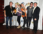 HOLLYWOOD, FL - OCTOBER 11: Chris Allen, Elaine Bradley, Tyler Glenn, Branden Campbell of Alternative rock band Neon Trees, manager of Hard Rock Cafe of Hollywood Scott Jacobs (L) and president of the Seminole Hard Rock Hotel & Casino Phil Madow donate sign bass guitar memorabilia  to Hard Rock Hotel at Hard Rock Cafe! in the Seminole Hard Rock Hotel & Casino on October 11, 2011 in Hollywood, Florida. (Photo by Johnny Louis/jlnphotography.com)
