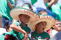 Los Angeles, CA -  Monday, June 23, 2014: Mexico fans cheer a Mexico goal while watching the Mexico vs. Croatia first round match at a public viewing at Plaza Mexico.
