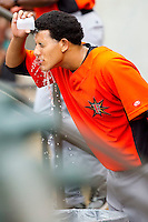 Manny Machado #3 of the Frederick Keys cools off with a cup of water prior to the game against the Winston-Salem Dash at BB&T Ballpark on August 5, 2011 in Winston-Salem, North Carolina.  The Dash defeated the Keys 10-0.   Brian Westerholt / Four Seam Images