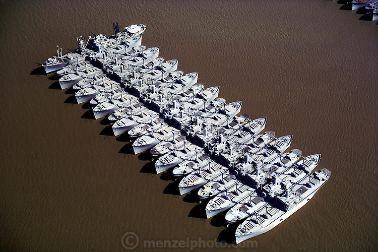 """Part of the """"Mothball fleet"""", a group of 78 outdated and decommissioned cargo ships, tankers, Victory ships, missile cruisers, barges and tugboats in Suisun Bay, California, USA..The Mothball Fleet is the largest single collection of ships on the Pacific Ocean. Though many are slated for scrap, most are being maintained for possible future use by US military and humanitarian organizations. ."""