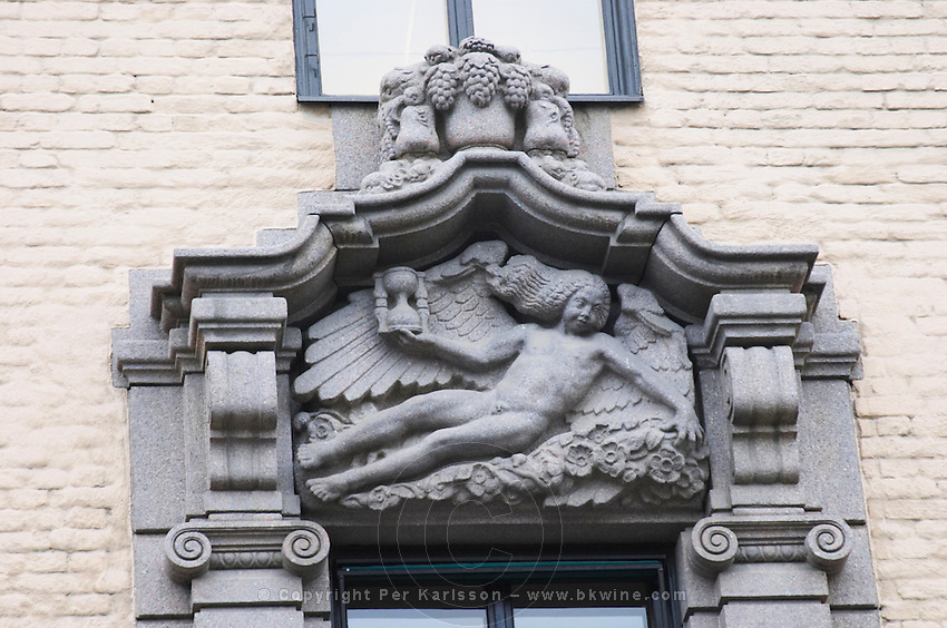 The corporate head office of Systembolaget, the Swedish monopoly alcohol retail company, designed by Erik Lallerstedt early 10th century. Stone sculptures on the facade. Stockholm. Sweden, Europe.