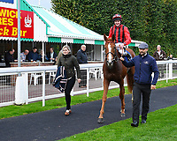 Winner of The Bathwickcarandvanhire.co.uk Handicap,Poseidon ridden by Liam keniry and trained by Ed Walker is led into the winners enclosure during Bathwick Tyres Reduced Admission Race Day at Salisbury Racecourse on 9th October 2017