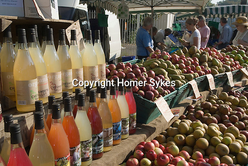 Apples and bottles and organcic apple and fruit drinks.  Blackheath Farmers Market. South East London. UK 2008.