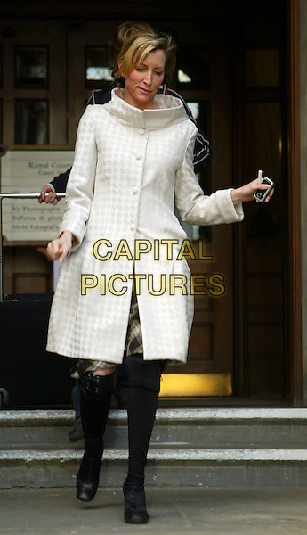 HEATHER MILLS.Leaving the High Court, her thrid visit in less than a week over her marriage split from Sir Paul McCartney..Royal Coutrs Of Justice, London, England, .March 6th 2007..full length sixities style white coat collar tartan plaid skirt wife ex-wife divorce black knee high boots.CAP/FEE.©Capital Pictures.