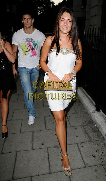 LACEY TURNER .At the Mango Tree Ladyboy Competition 2008 Final, Mango Tree restaurant, London, England, July 27th 2008..full length white gold beaded dress wedges clutch bag platforms ankle strap.CAP/CAN.©Can Nguyen/Capital Pictures