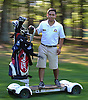 Hampton Hills Golf &amp; Country Club staff member Luis Solorzano, 19, poses for a portrait riding a Golfboard on the greens on Wednesday, July 22, 2015.<br /> <br /> James Escher
