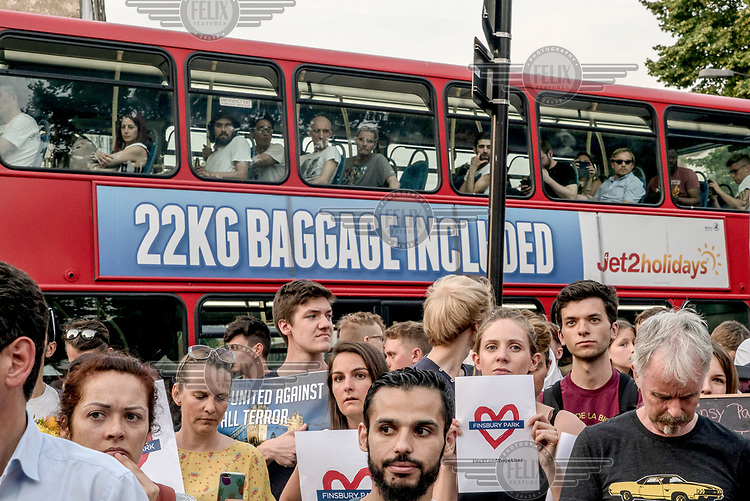 A bus passes a vigil for victims of the Finsbury Park mosque terrorist attack. On 19 June 2017 a van, allegedly by driven by Darren Osborne who is currently in custody, was deliberately driven into worshippers leaving the mosque, killing one man and injuring 10 others.