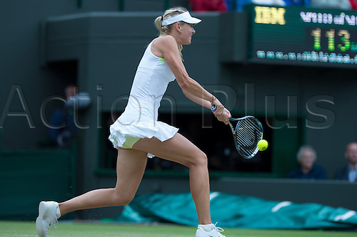02.07.2012.   The All England Lawn Tennis and Croquet Club. London, England. Maria Sharapova of Russia in action against Sabine Lisicki of Germany  during fourth round qualifying at Wimbledon Tennis Championships at The All England Lawn Tennis and Croquet Club. London, England, UK