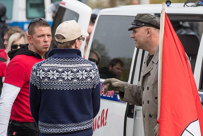 Ca. 1000 Nazis aus ganz Deutschland marschierten am Sonntag den 1. Mai 2016 im Saeschsichen Plauen auf. Die Naziorganisation 3.Weg hatte den Marsch angemeldet. Etliche Nazis waren dabei vermummt und zeigten auch den Hitlergruss, die Polizei schritt jedoch nicht ein.<br /> Nach der Haelfte der Marschroute beendeten die Nazis ihre Demonstration, da die Polizei die Marschroute verkuerzen wollte. Sie forderten die Polizei auf den Weg freizugeben. Danach griffen Aufmarschteilnehmer die Polizei an, die daraufhin Wasserwerfer, Pfefferspray, Traenengas und Schlagstoecke einsetzte. Mehrere Gruppen Nazis zogen danach durch Plauen und jagten Menschen.<br /> Nach einer Stunde bekamen die Nazis einen erneuten Aufmarsch von der Polizei genehmigt und zogen zurueck zum Bahnhof.<br /> Links im Bild: Tony Gentsch. Gentsch hat massgeblich die verbotene Naziorganisation &quot;Freies Netz Sued&quot;, FNS, geleitet und war Aktivis im verbotenen &quot;Kampfbund Deutscher Sozialisten&quot;, KDS. Er ist mit am Naziversandhandel &quot;Final Resistance&quot; beteiligt.<br /> Rechts im Bild: mit Hamburg-Fahne: Thomas &quot;Steiner&quot; Wulff, Nazianfuehrer aus Hamburg. Seinen Spitznamen hat er sich vom SS Obergruppenfuehrer Felix Steiner genommen.<br /> 1.5.2016, Plauen<br /> Copyright: Christian-Ditsch.de<br /> [Inhaltsveraendernde Manipulation des Fotos nur nach ausdruecklicher Genehmigung des Fotografen. Vereinbarungen ueber Abtretung von Persoenlichkeitsrechten/Model Release der abgebildeten Person/Personen liegen nicht vor. NO MODEL RELEASE! Nur fuer Redaktionelle Zwecke. Don't publish without copyright Christian-Ditsch.de, Veroeffentlichung nur mit Fotografennennung, sowie gegen Honorar, MwSt. und Beleg. Konto: I N G - D i B a, IBAN DE58500105175400192269, BIC INGDDEFFXXX, Kontakt: post@christian-ditsch.de<br /> Bei der Bearbeitung der Dateiinformationen darf die Urheberkennzeichnung in den EXIF- und  IPTC-Daten nicht entfernt werden, diese sind in digitalen Medien nach &sect;95c UrhG r