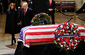 President Donald Trump and first lady Melania Trump arrive to pay their respects to former President George H. W. Bush lying in state in the U.S. Capitol Rotunda Monday, Dec. 3, 2018, in Washington. (AP Photo/Pablo Martinez Monsivais/Pool)
