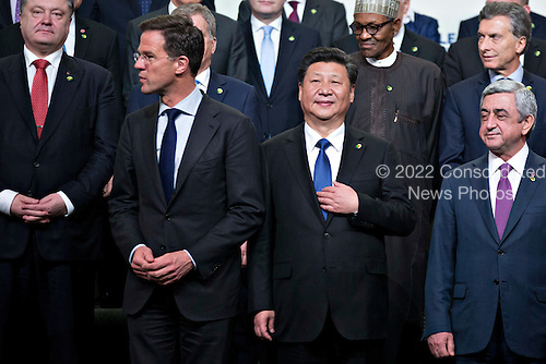 Serzh Sargsyan, Armenia's president, from right, Xi Jinping, China's president, and Mark Rutte, Dutch prime minister, stand during a family photo at the Nuclear Security Summit in Washington, D.C., U.S., on Friday, April 1, 2016. After a spate of terrorist attacks from Europe to Africa, U.S. President Barack Obama is rallying international support during the summit for an effort to keep Islamic State and similar groups from obtaining nuclear material and other weapons of mass destruction. <br /> Credit: Andrew Harrer / Pool via CNP