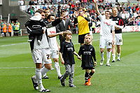 Npower Championship, Swansea City FC (white) V Sheffield United. Sat 7th May 2011 (12.45pm KO)<br /> The Swans celebrate reaching the playoffs with a lap arond the ground<br /> Pictured: Angel Rangel<br /> Picture by: Ben Wyeth / Athena Picture Agency<br /> info@athena-pictures.com<br /> 07815 441513