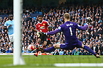 Marcus Rashford of Manchester United scores the opening goal during the Barclays Premier League match at the Etihad Stadium. Photo credit should read: Philip Oldham/Sportimage