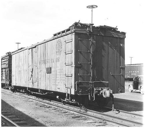 3/4 view of short reefer #77 at Alamosa.<br /> D&amp;RGW  Alamosa, CO  Taken by Polkinghorn, R. S. - 1946