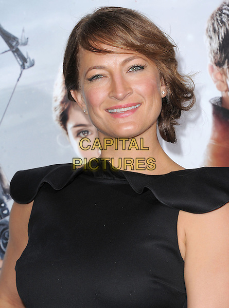 Zoe Bell.attending the Paramount Los Angeles film premiere of 'Hansel and Gretel: Witch Hunters', held at The Grauman's Chinese Theater in Hollywood, California, USA, January 24th 2013..portrait headshot smiling fringe black ruffle                                                             .CAP/DVS.©Debbie VanStory/Capital Pictures.