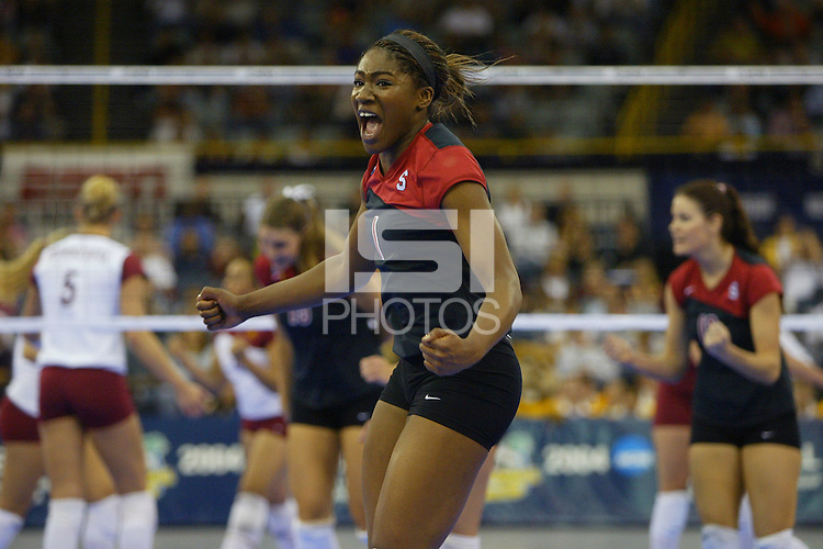 18 December 2004: Stanford Cardinal Ogonna Nnamani in Game 3during Stanford's  30-23, 30-27, 30-21 victory over Minnesota in the 2004 NCAA Women's Volleyball National Championships in Long Beach, CA. Stanford won their sixth women's volleyball title in school history. Nnamani was named the tournament's Most Outstanding Player and broke the tournament record for kills.<br />