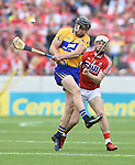 John Conlon of Clare in action against Luke Meade of Cork during their Munster senior hurling final at Thurles. Photograph by John Kelly.