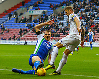 Leeds United's Liam Cooper is tackled by Wigan Athletic's Dan Burn<br /> <br /> Photographer Alex Dodd/CameraSport<br /> <br /> The EFL Sky Bet Championship - Wigan Athletic v Leeds United - Sunday 4th November 2018 - DW Stadium - Wigan<br /> <br /> World Copyright &copy; 2018 CameraSport. All rights reserved. 43 Linden Ave. Countesthorpe. Leicester. England. LE8 5PG - Tel: +44 (0) 116 277 4147 - admin@camerasport.com - www.camerasport.com