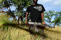 Zambia Chiawa, Game Reserve Area of Lower Zambezi Nationalpark, Ranger and Scout with Kalashnikov AK-47 / SAMBIA Chiawa, Game Reserve Area des Lower Zambezi Nationalpark, Privatgelaende und Lodge des Unternehmers Charles Daves aus Simbabwe, Ranger und Scout mit AK-47