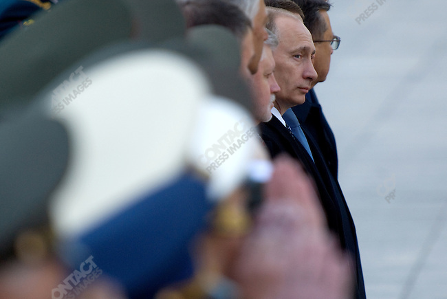 Vladimir Putin, the former president of Russia, today named prime minister, stood with other members of the government after laying flowers at the tomb of the unknown soldier at the walls of the Kremlin commemorating the fallen of World War II as an honour guard marched past. Moscow, Russia, May 8, 2008