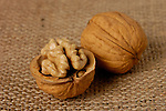 Walnut closeup over sacking background artistic food still life