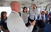 NWA Democrat-Gazette/DAVID GOTTSCHALK   Jeff Hatley, mobility manager and public information officer with Ozark Regional Transit Authority, explains the operations of the yard at Ozark Regional Traffic in Springdale to teachers from Thomas Jefferson Elementary School in Bentonville Wednesday, August 12, 2015. The teachers are participating in back to school activities that include visiting non profit organizations.