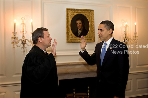 Washington, DC - January 21, 2009 -- Chief Justice of the UNited States John G. Roberts Jr. administers the oath of office a second time in the Map Room of the White House on Wednesday, January 21, 2009. .Credit: Pete Souza - White House via CNP