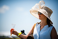 BALTIMORE, MD - MAY 19: A woman drinks champagne on Black-Eyed Susan Day at Pimlico Race Course on May 19, 2017 in Baltimore, Maryland.(Photo by Douglas DeFelice/Eclipse Sportswire/Getty Images)