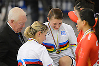 KRISTINA VOGEL and MIRIAM WELTE of Germany receive their medals for winning the Team Sprint event on day 1 of the 2012 UCI Track Cycling World Championships at Hisense Arena in Melbourne, Australia. Photo Sydney Low. Copyright Sydney Low. All rights reserved. No reproduction permitted. Access via FlickrAPI not permitted.